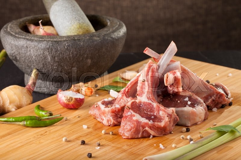 Thai Rack of lamb, Raw rack of lamb cut in pieces decorate and seasoning with Thai herb, stock photo