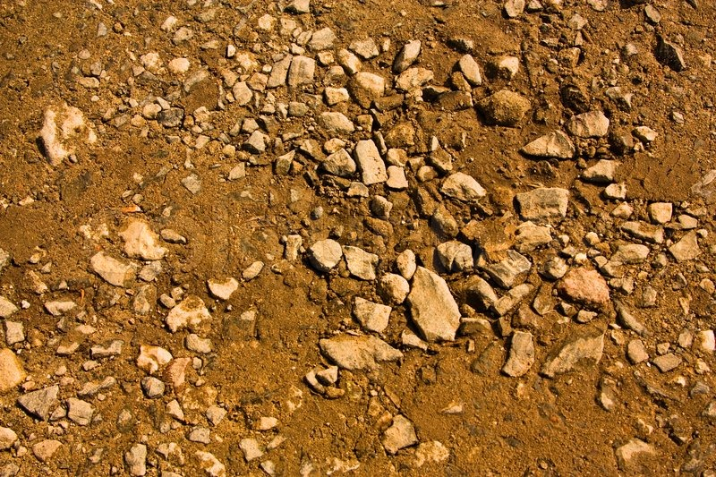 Dirt And Stone : Gravel clay and sand in the background stock photo