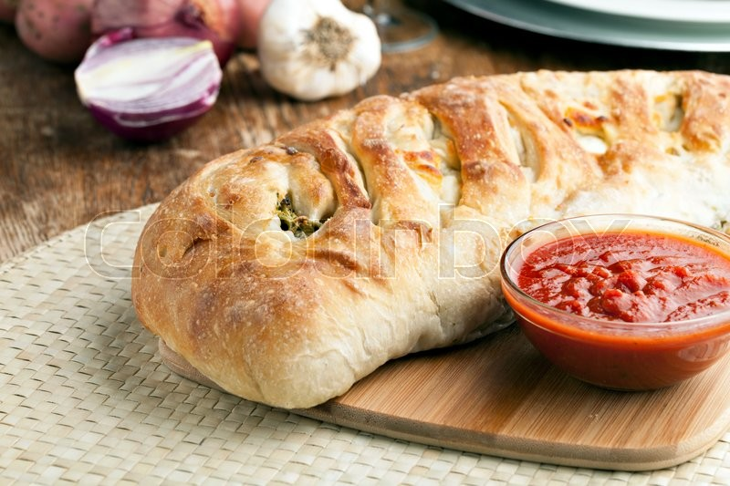 Stock image of 'Homemade stromboli or stuffed bread with broccoli ...