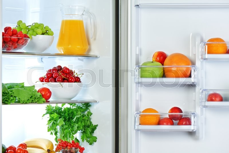 The refrigerator with healthy food fruits and vegetables, stock photo