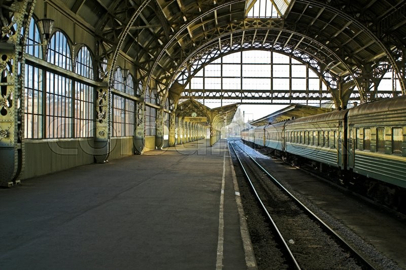 Railroad station platform in Saint Petersburg, Russia, with hanging clocks and \