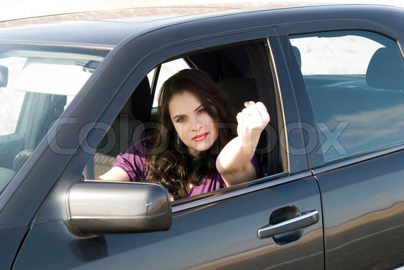 Angry woman in her car | Stock Photo | Colourbox