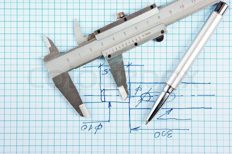 Technical drawing and callipers with pen on graph paper, stock photo