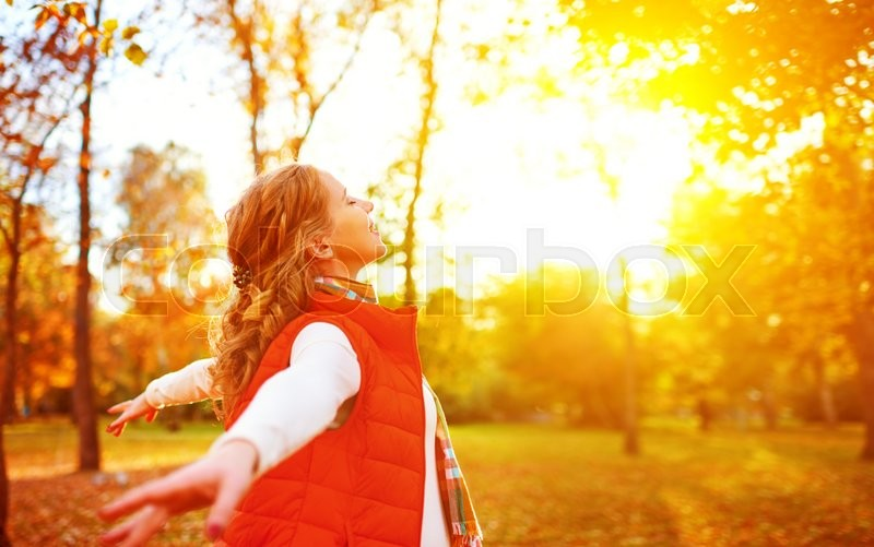 Happy girl enjoying life and freedom in the autumn on the nature, stock photo