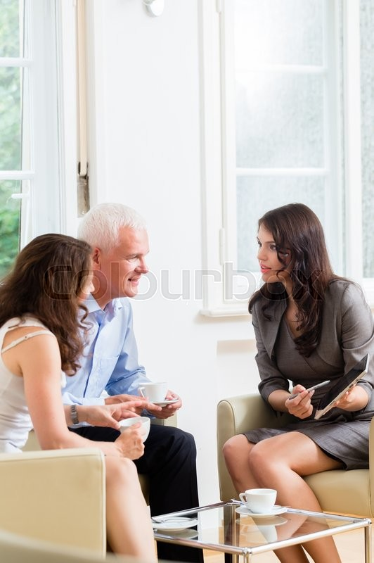 Advisor giving investment and retirement advice to senior woman and man, stock photo