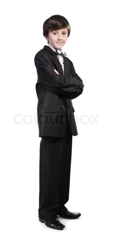 ein junge in einem schwarzen anzug wei es hemd und fliege auf einem wei en hintergrund stock. Black Bedroom Furniture Sets. Home Design Ideas