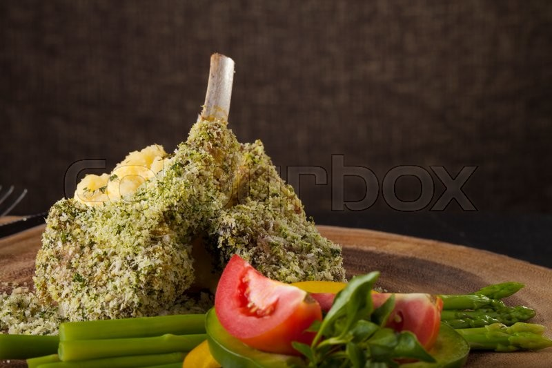 Rack of lamb mint steak, Rack of lamb steak cut in pieces seasoning with crusted mint vegetable and herbs and red wine serve on chopping wood block, stock photo