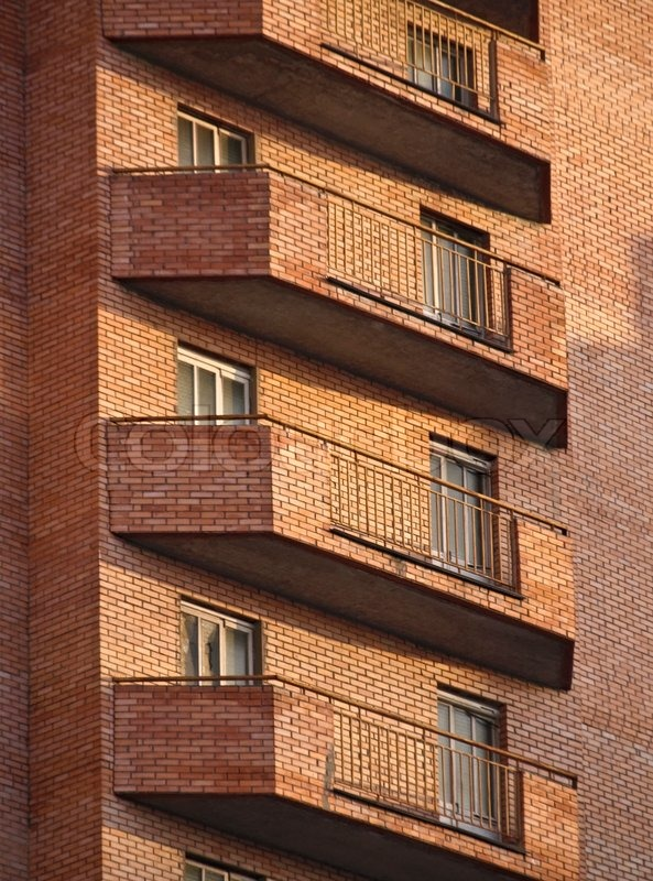 New high rise brick building with balconies stock photo for Building balcony