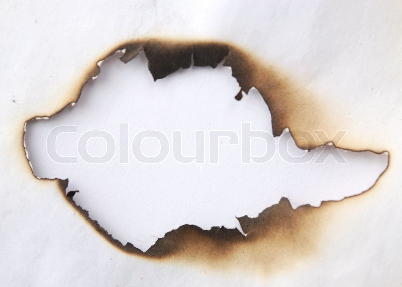 Burnt hole on old paper stock photo 262506701