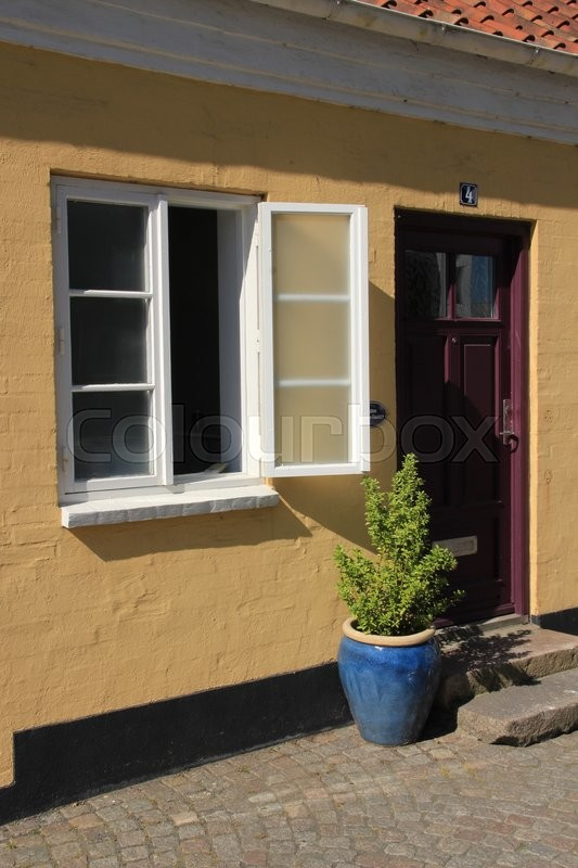 The House With The Open Window And A Closed Purple Front Door In The