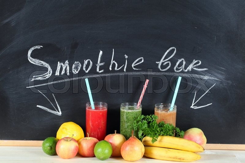 Fruit smoothies on a chalk board whith letters - Smoothie bar, stock photo