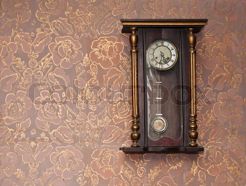 Antique Clock On The Wall With Textured Wallpaper Stock Photo