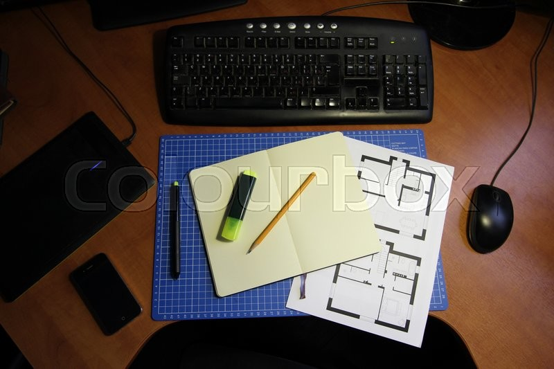Freelance Designer or Architect Home Workspace. Table with Computer and other Stuff, stock photo