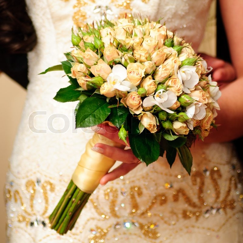 Wedding bouquet from peach-coloured roses and buds | Stock Photo ...