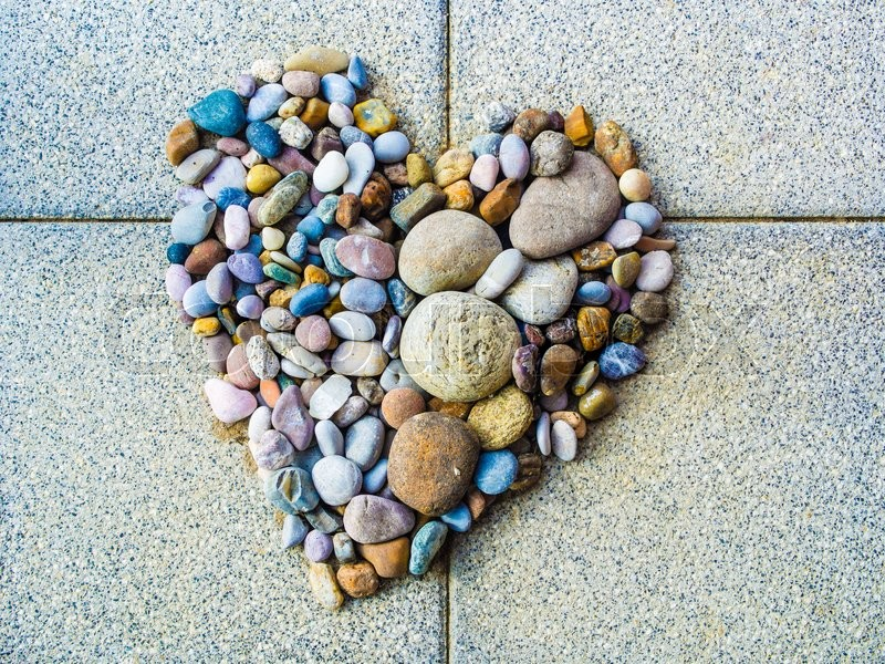 Heart made of colorful pebbles, love and diversity, stock photo