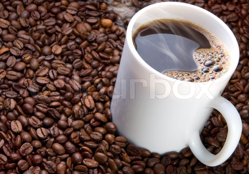 470ee752f5c Mug of hot coffee on a coffee beans ... | Stock image | Colourbox