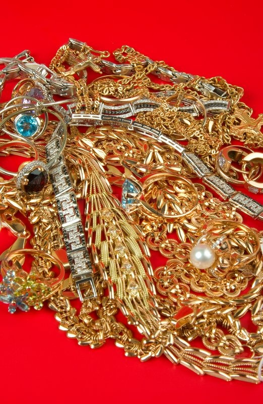 Pile of Gold Jewelry on a red background Stock