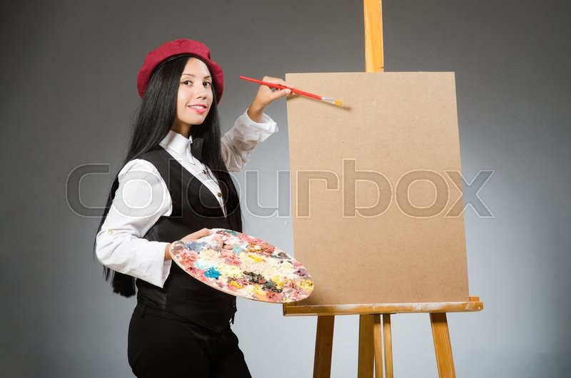 Funny artist working in the studio, stock photo
