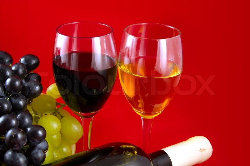 Two glasses with white and red wine on a red background a for Red glass wine bottles suppliers