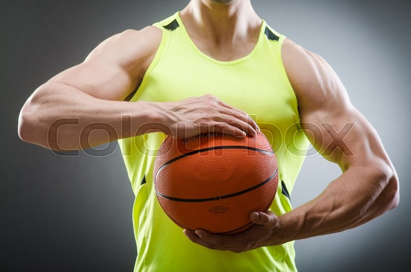 Muscular basketball in sports concept, stock photo