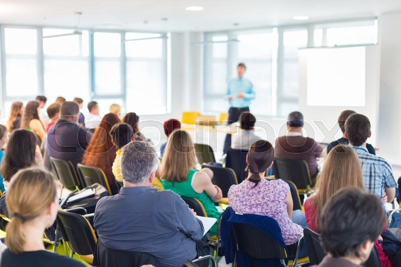 Speakers Giving a Talk at Business Meeting. Audience in the conference hall. Business and Entrepreneurship concept, stock photo