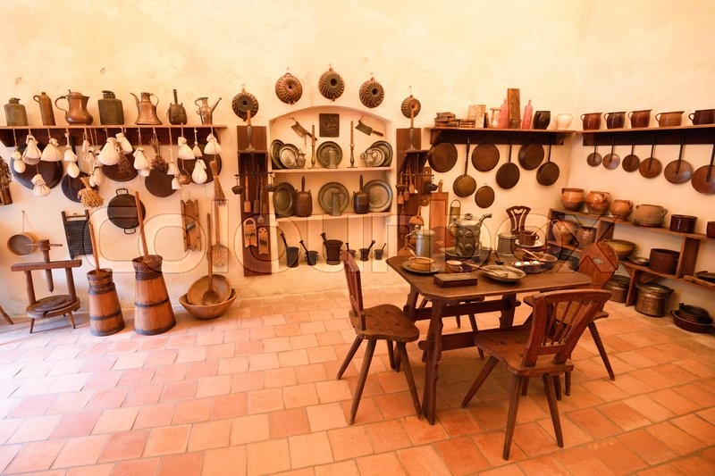 Old Medieval Castle Kitchen With Variety Of Dishes Stock Photo