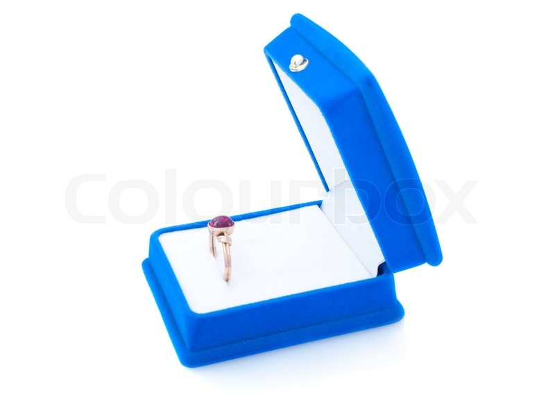 Gold ring with ruby in blue velvet jewelry box isolated on white