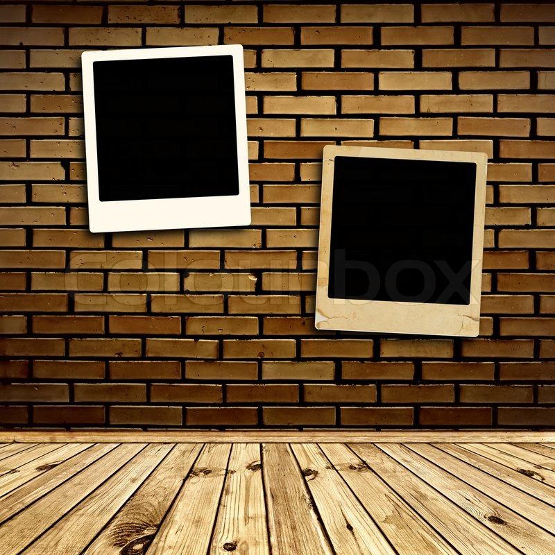 Two Photo Frames At Brick Wall Stock Photo Colourbox