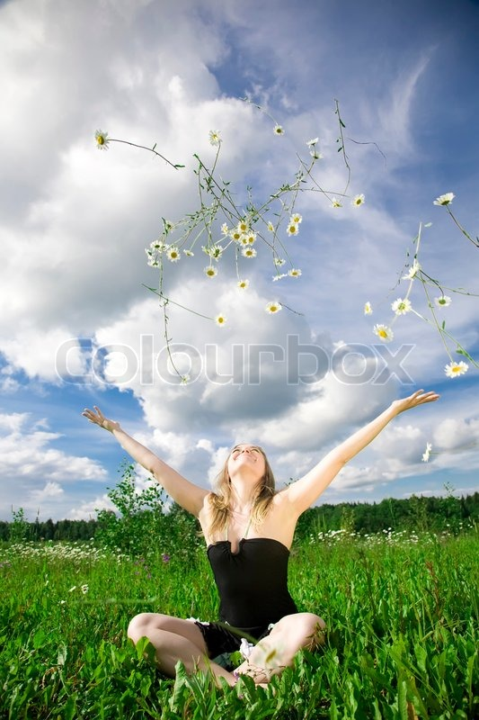 Stock image of 'Happy Summer. Woman Relaxing On The Meadow.'