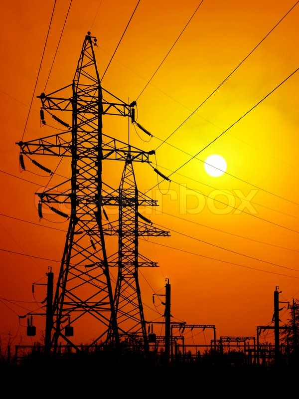 Transmission towers on sunset background. | Stock Photo ...
