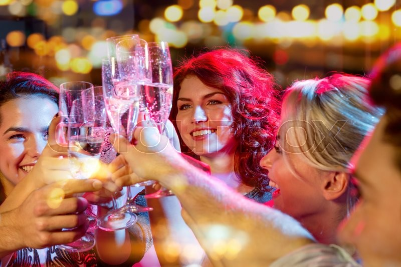 Party, holidays, celebration, nightlife and people concept - smiling friends with glasses of champagne in club, stock photo