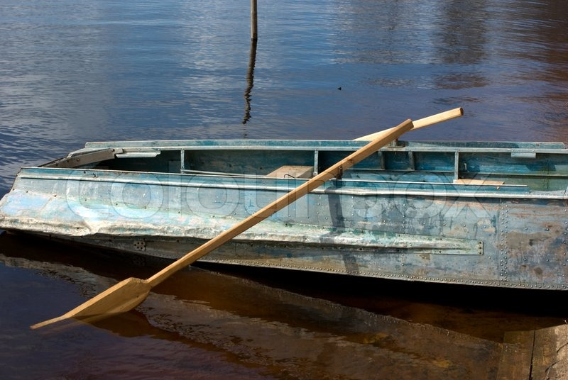Boat With Wooden Oars On River Bank Stock Photo Colourbox