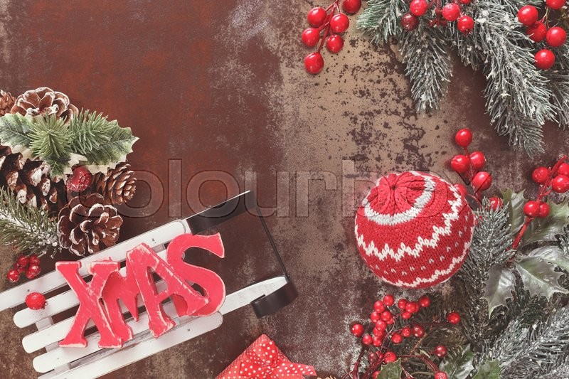new year and christmas decoration with sled christmas background with woolly decoration and xmas letters on sledge rustic wood background with blank space - Vintage Sled Christmas Decoration