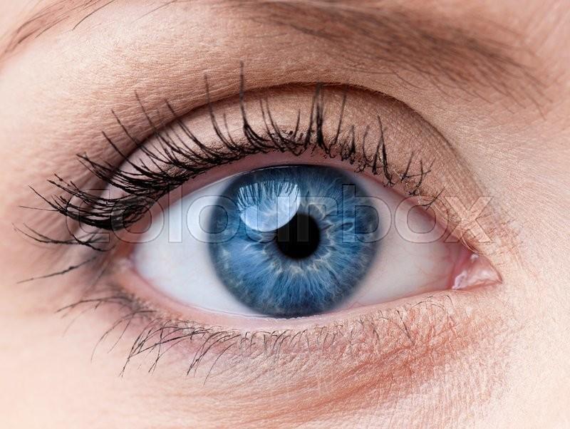 Beautiful blue woman single eye close up, stock photo