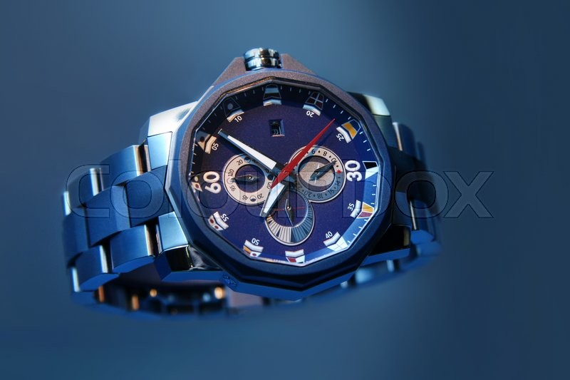 Swiss watches on blue background. Product photography, stock photo