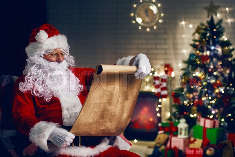 Portrait Of Santa Claus Sitting At His Room At Home Near