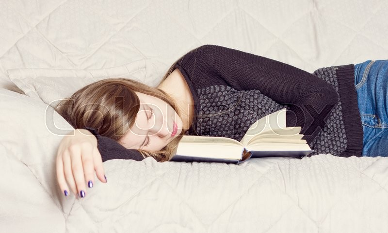 Cute Girl Sleeping While Holding A Book   Stock Image -7923