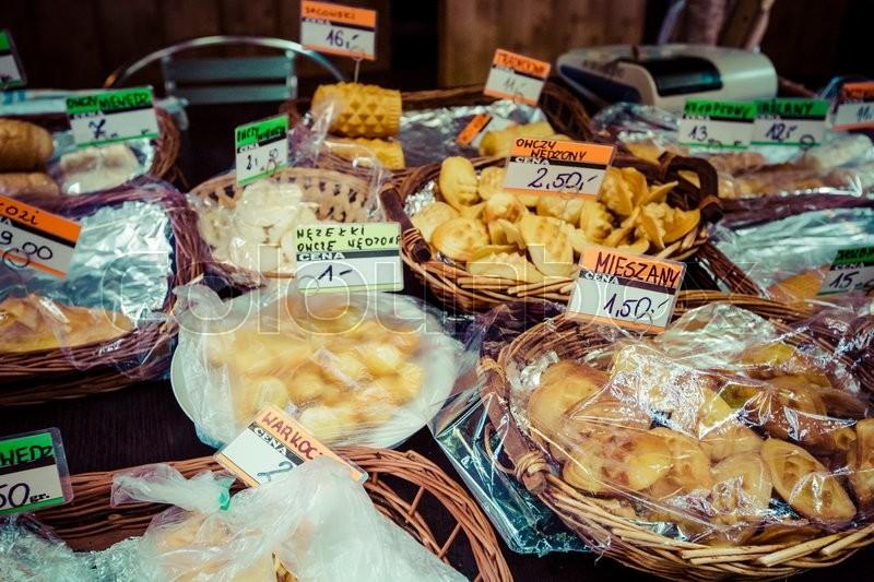 Traditional polish smoked cheese oscypek on outdoor market in Zakopane , stock photo