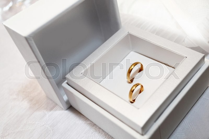 Wedding rings of yellow gold in satin box, stock photo