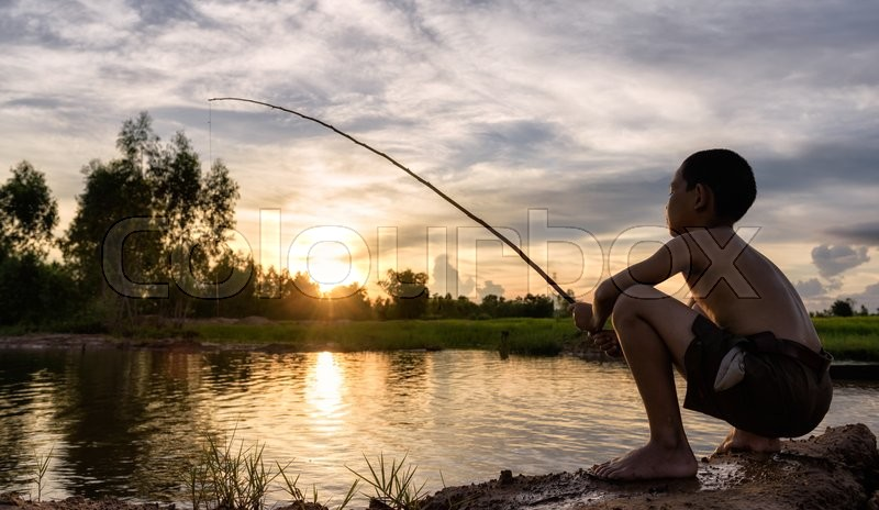 Boy fishing, stock photo