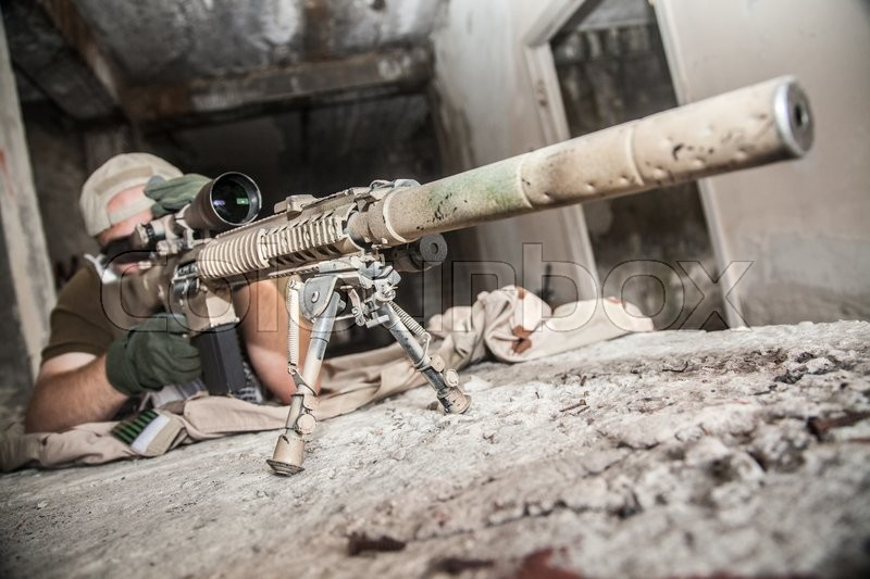 Navy Seal Sniper with rifle in action , stock photo
