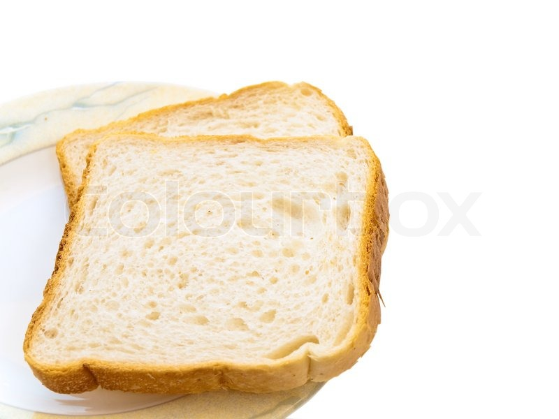 Two pieces of white bread at the plate | Stock Photo ...