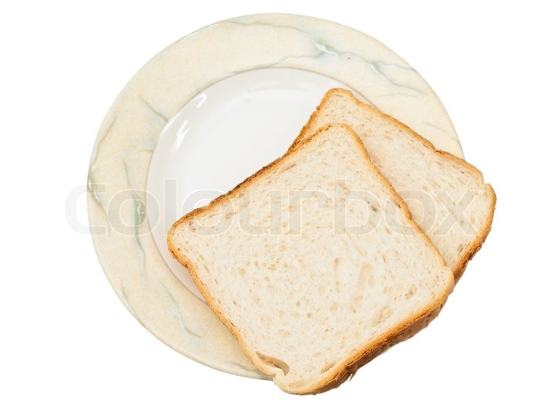 Two pieces of bread at plate against white | Stock Photo ...