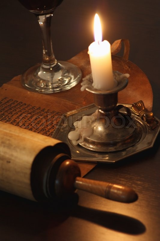 Ancient Manuscript In The Light Of Candles Stock Photo