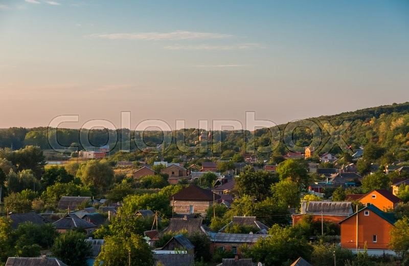 Houses in the village early in the morning at sunrise summer, stock photo