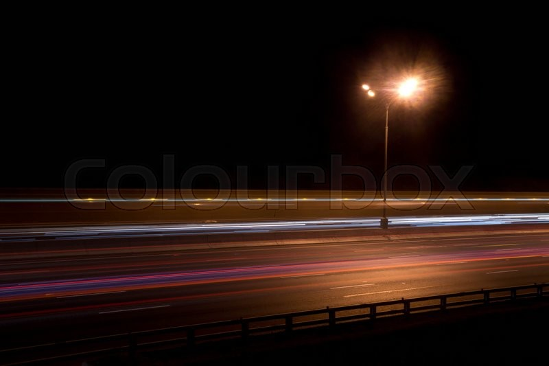 Street lamp on the road at night, stock photo