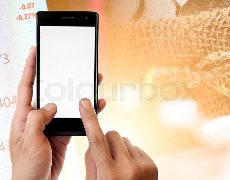 Hand holding smart phone on Money and the graph them,online banking make money concept, stock photo