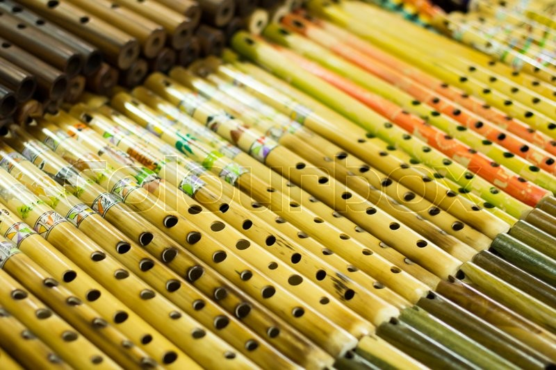 Authentic south american panflutes in local market in Peru, stock photo