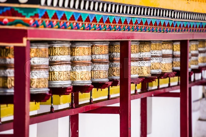 Buddhist prayer wheels in Tibetan     | Stock image | Colourbox