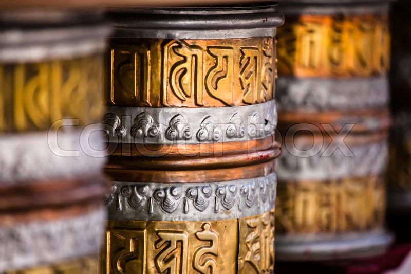 Buddhist prayer wheels in Tibetan     | Stock image | Colourbox